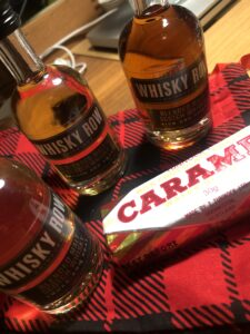Whisky samples and a Caramel Wafer on a tartan background